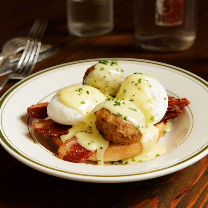 That's the Balls Benedict: two poached eggs, bacon, your choice of meatballs, and hollandaise on a brioche bun.