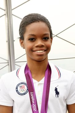 Gymnast Gabby Douglas poses at The Empire State Building on August 14, 2012 in New York City.