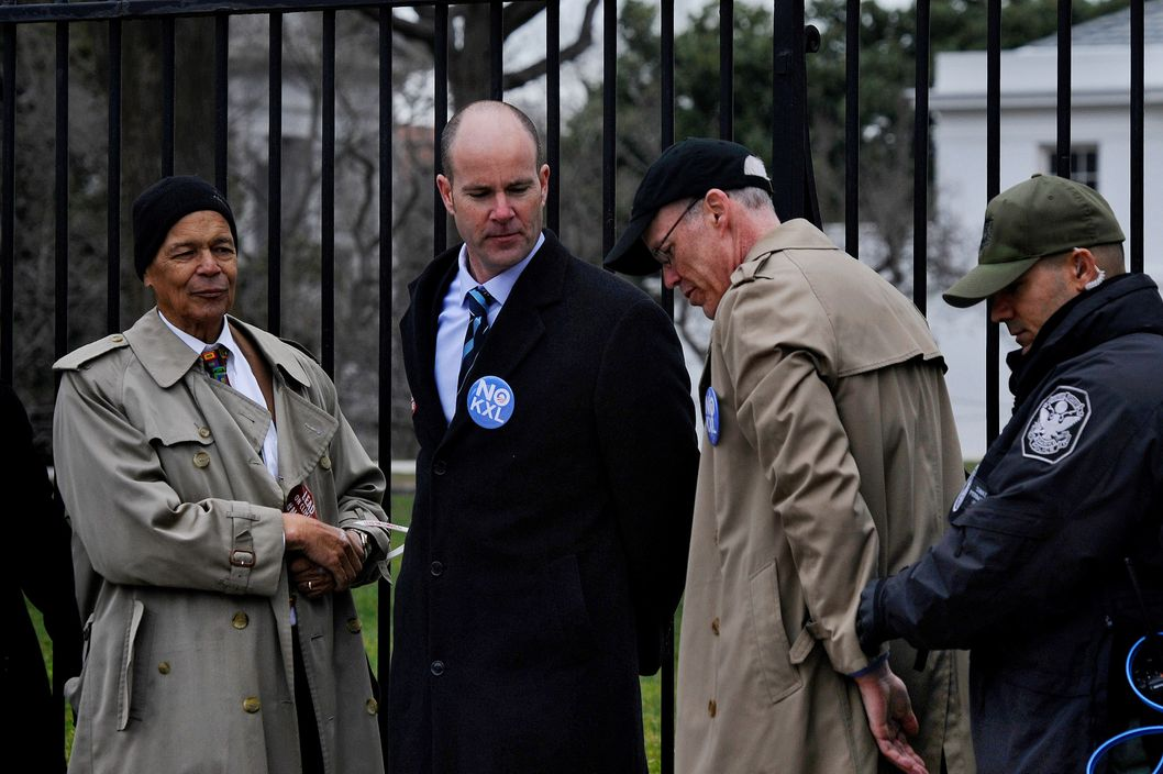 A variety of climate and social justice groups came to Washington today to protest the proposed Keystone XL Pipeline. 48 were arrested as they refused to leave the sidewalk in front of the White House. Among them were L to R: social justice activist Julian Bond, Sierra Club Executive Dir. Michael Brune and Bill McKibben, an author and environmental activist.