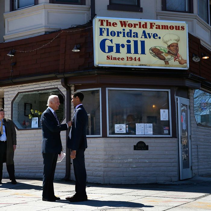 WASHINGTON, DC - MARCH 26: U.S. Vice President Joe Biden talks with Florida Avenue Grill owner Imar Hutchins after visiting the restaurant March 26, 2014 in Washington, DC. Biden visited the diner to highlight the administration's efforts to raise the national minimum wage to $10.10 an hour. (Photo by Win McNamee/Getty Images)