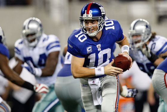 ARLINGTON, TX - SEPTEMBER 20:  Quarterback Eli Manning #10 of the New York Giants during play against the Dallas Cowboys at Cowboys Stadium on September 20, 2009 in Arlington, Texas.  (Photo by Ronald Martinez/Getty Images)