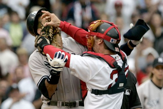 Boston Red Sox catcher Jason Varitek, right, strikes New York Yankees batter Alex Rodriguez at Fenway Park in Boston. The two fought after Rodriguez was hit by a pitch by Red Sox pitcher Bronson Arroyo. The Red Sox won, 11-10,  with a 9th-inning game winning home run by Bill Mueller. (Photo by J Rogash/Getty Images)