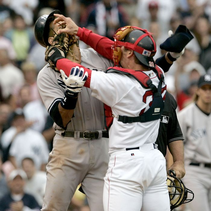 Boston Red Sox catcher Jason Varitek, right, strikes New York Yankees batter Alex Rodriguez at Fenway Park in Boston.