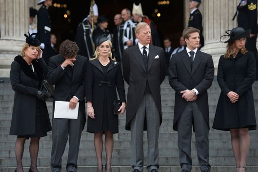 (L-R) Carol Thatcher, Marco Grass, Sarah Thatcher, Mark Thatcher, Michael Thatcher and Amanda Thatcher look on from the steps of St Paul's Cathedral as the coffin is placed in the hearse after the Ceremonial funeral of former British Prime Minister Baroness Thatcher at St Paul's Cathedral on April 17, 2013 in London, England. Dignitaries from around the world today join Queen Elizabeth II and Prince Philip, Duke of Edinburgh as the United Kingdom pays tribute to former Prime Minister Baroness Thatcher during a Ceremonial funeral with military honours at St Paul's Cathedral. Lady Thatcher, who died last week, was the first British female Prime Minister and served from 1979 to 1990.