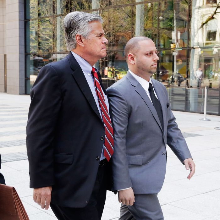 New York Senate Majority Leader Dean Skelos, center, and his son Adam, right. arrive at FBI offices, Monday, May 4, 2015, in New York. The pair surrendered to face charges including extortion and soliciting bribes amid a federal investigation into the awarding of a $12 million contract to a company that hired his son. (AP Photo/Mark Lennihan)
