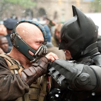 """(L-r) TOM HARDY as Bane and CHRISTIAN BALE as Batman in Warner Bros. Pictures' and Legendary Pictures' action thriller """"THE DARK KNIGHT RISES,"""" a Warner Bros. Pictures release. TM and ? DC Comics"""