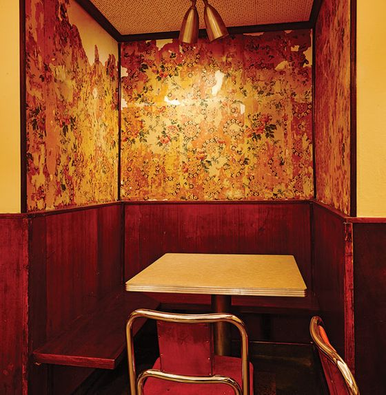 "Cecchini, a Wisconsin native, has dubbed the narrow barroom's adjacent seating area the ""Packer Room."" It features a ""make-out"" alcove lined with old floral wallpaper excavated during renovations, and plans include a stealth TV that springs out from behind a painting during Green Bay games only."