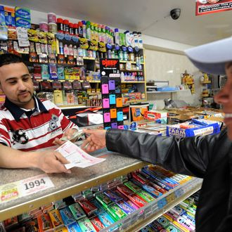 Clerk Abdulwali Mohamed Osaim (L) sells Mega Millions lottery tickets at a convenience store on the east side of Manhattan March 30, 2012 in New York. The jackpot is at a record level because no one has matched the magic five numbers and Mega Ball since January 24 -- a full 18 drawings with no winner. Given the pace of the ticket buying, the jackpot will go even higher. A lottery spokesman reportedly has announced that the jackpot has risen to $640 million.