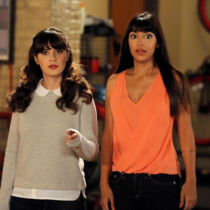 NEW GIRL: Jess (Zooey Deschanel, L) and Cece (Hannah Simone, R) are forced to stay in the loft and go on a spider hunt in the all-new