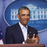 US President Barack Obama applauds retiring ABC reporter Ann Compton as he speaks about the US involvement in Iraq, as well as the situation in Ferguson, Missouri, in the Brady Press Briefing Room of the White House in Washington, DC, August 18, 2014. AFP PHOTO / Saul LOEB        (Photo credit should read SAUL LOEB/AFP/Getty Images)