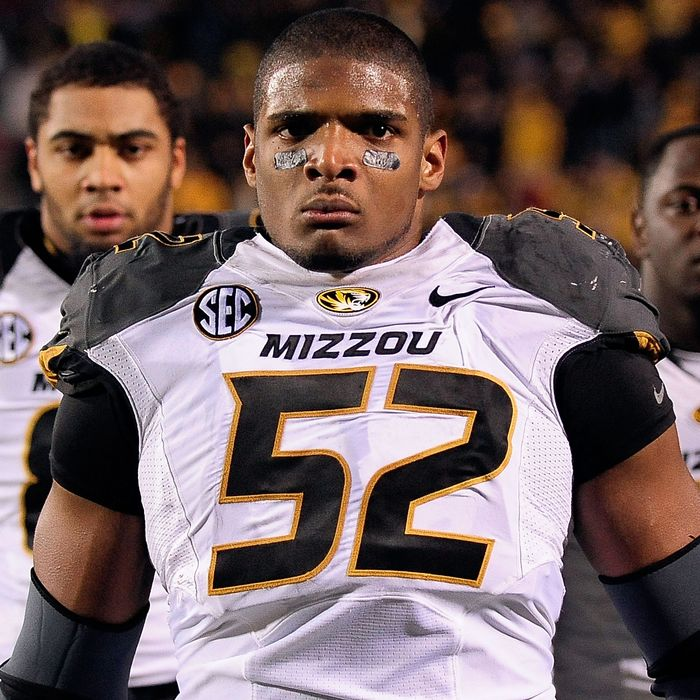 Michael Sam #52 of the Missouri Tigers participates in pregame activities prior to a game against the Ole Miss Rebels at Vaught-Hemingway Stadium on November 23, 2013 in Oxford, Mississippi.