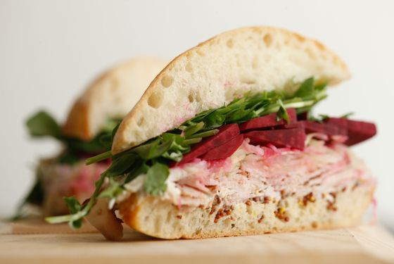 Ciabatta with house-made porchetta, Brussels-sprout kraut, pickled beets, pea shoots, mustard, and horseradish creme fraiche.