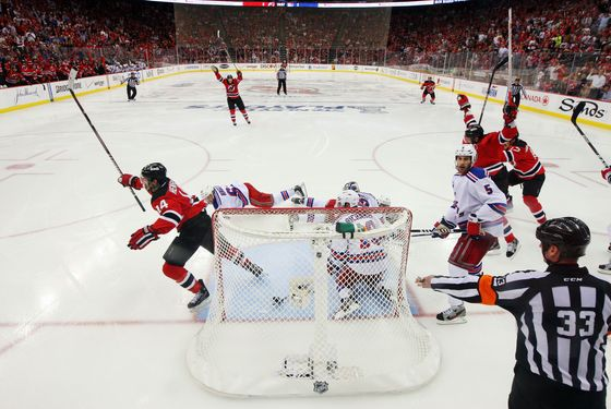 NEWARK, NJ - MAY 25:  Adam Henrique #14 of the New Jersey Devils celerbates after scoring the game winning goal in overtime against Henrik Lundqvist #30 of the New York Rangers to win Game Six of the Eastern Conference Final and advance to the 2012 NHL Stanley Cup Final at the Prudential Center on May 25, 2012 in Newark, New Jersey.  (Photo by Jim McIsaac/Getty Images)