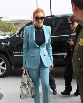 LOS ANGELES, CA - MARCH 29: Lindsay Lohan arrives at the LAX Courthouse to attend a final status hearing relating to the criminal cases against her, on March 29, 2012 in Los Angeles, California. Since her last court hearing, Lohan has completed 60 hours of community service work and attended couseling sessions while on probation, following convictions for shoplifting and violation of probation concerning her driving-under-the-influence conviction of 2007. (Photo by JB Lacroix/WireImage)