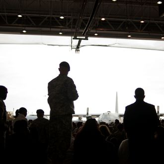 FORT BRAGG, NC - DECEMBER 14: Troops wait for the arrival of President Barack Obama and the First Lady Michelle Obama during a Presidential visit to honor troops returning home from Iraq on December 14, 2011 to Fort Bragg, N.C. America is ending its war in Iraq and all U.S. troops are scheduled to be removed from Iraq by December 31.(Photo by Davis Turner/Getty Images)