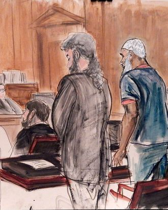 In this courtroom sketch Sulaiman Abu Ghaith, center right, Osama bin Laden's son-in-law, stands next to attorney Stanley Cohen, center, as interpreter Marwan Abdel-Rahman, right, quotes from the Quran on behalf of Abu Ghaith during his sentencing hearing in New York, Tuesday, Sept. 23, 2014. U.S. District Judge Lewis A. Kaplan, left, sentenced Abu Ghaith to life in prison for acting as al-Qaida's spokesman after the Sept. 11, 2001, terror attacks The judge said he saw