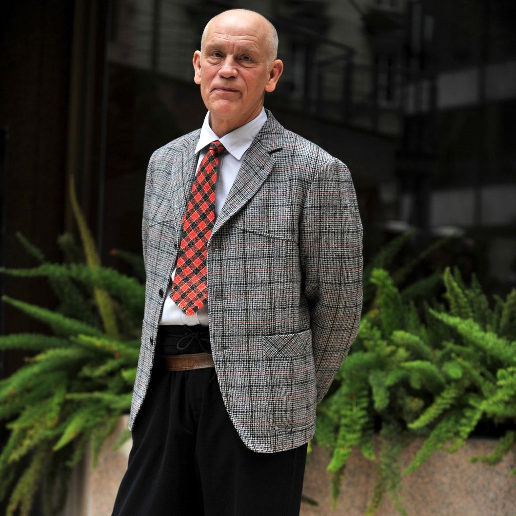 "US actor John Malkovich poses during a photocall for the film ""Educazione Siberiana"" on February 22,  2013 in Rome."
