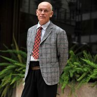 """US actor John Malkovich poses during a photocall for the film """"Educazione Siberiana"""" on February 22,  2013 in Rome."""