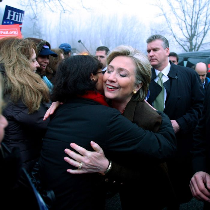 05 Feb 2008, Chappaqua, New York State, USA --- Democratic presidential candidate Senator Hillary Clinton (C) greets supporters in front of the Douglas Grafflin Elementary School after she voted in the New York State Democratic Primary in Chappaqua, New York. --- Image by ? Michael Nagle/epa/Corbis