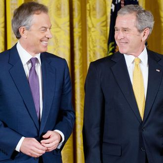 US President George W. Bush smiles along