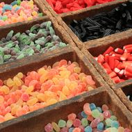 Close-up image of a group of sugar coated sweet candies and licorice for sale.