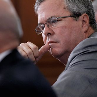 WASHINGTON, DC - JUNE 01: Former Florida Governor Jeb Bush (C) listens to opening statements while testifying before the House Budget Committee in the Cannon House Office Building on Capitol Hill June 1, 2012 in Washington, DC. The committee members engaged in a wide-ranging debate about tax and spending policy during the hearing titiled,