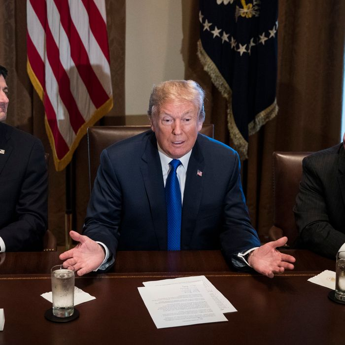 Flanked by Speaker of the House Paul Ryan and House Ways and Means Committee chairman Rep. Kevin Brady (R-TX), President Donald Trump speaks about tax reform legislation.