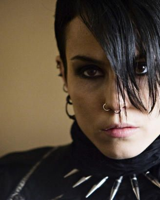 Noomi Rapace smiling for the camera as Lisbeth Salander.