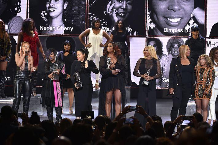 Eve, Missy Elliott, DJ Spinderella, Cheryl 'Salt' James, Sandra 'Pepa' Denton, Queen Latifah, and Lil' Kim.