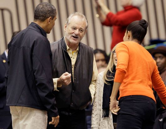 Actor Bill Murray, center, chats with President Barack Obama, left, and first lady Michelle Obama before an NCAA basketball game between Oregon State and Towson in Towson, Md., Saturday, Nov. 26, 2011. (AP Photo/Patrick Semansky)