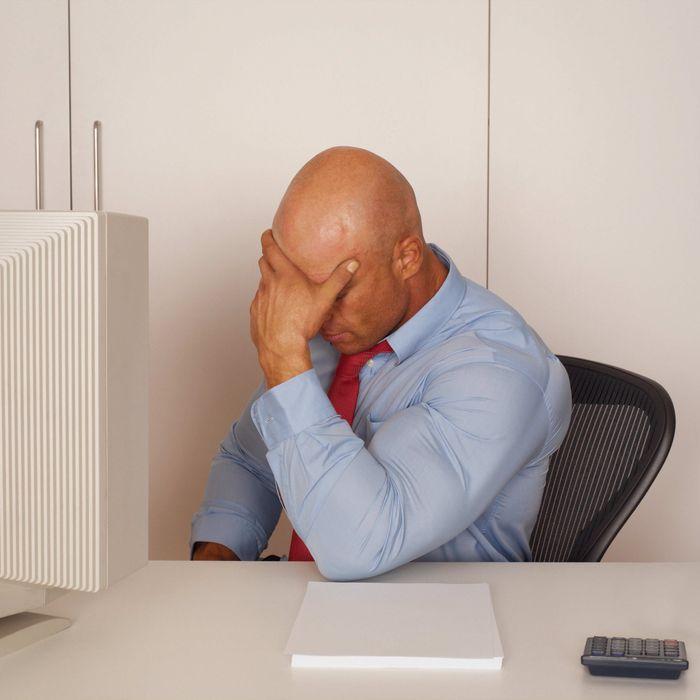 Dejected Man Sitting at Desk