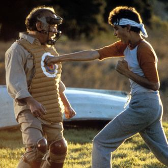 Ralph Macchio punches a dummy in a scene from the film 'The Karate Kid', 1984. (Photo by Columbia Pictures/Getty Images)