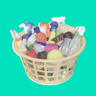 Cleaning products in laundry basket --- Image by ? Neville Mountford-Hoare/PhotoAlto/Corbis