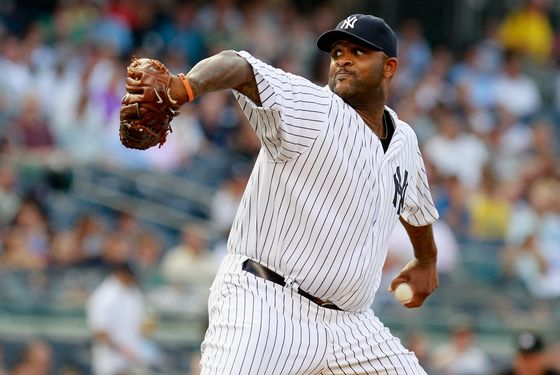 NEW YORK, NY - JULY 17: CC Sabathia #52 of the New York Yankees pitches in the first-inning against the Toronto Blue Jays at Yankee Stadium on July 17, 2012 in the Bronx borough of New York City.  (Photo by Mike Stobe/Getty Images)
