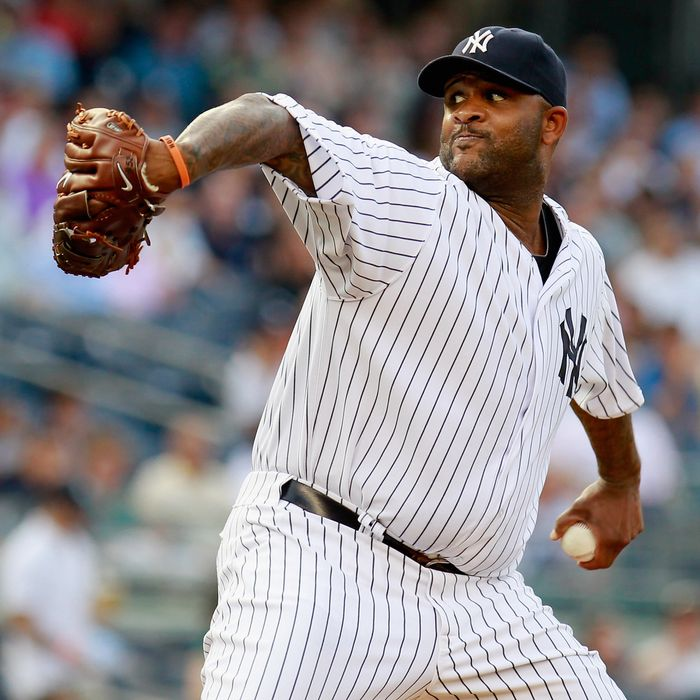CC Sabathia #52 of the New York Yankees pitches in the first-inning against the Toronto Blue Jays at Yankee Stadium on July 17, 2012
