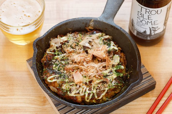 Okonomiyaki: classic Osaka-style cabbage-and-pork-belly savory pancake.
