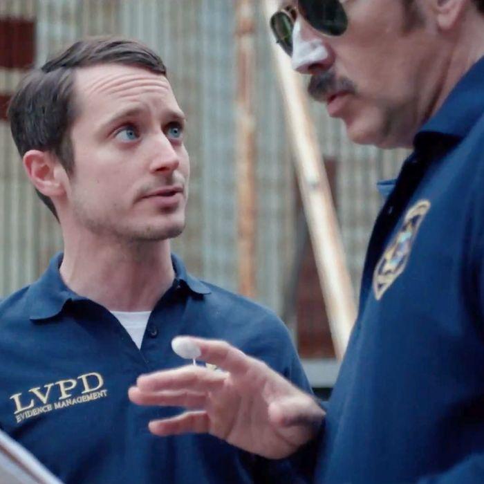 Elijah Wood and Nicolas Cage in <em>The Trust</em>.