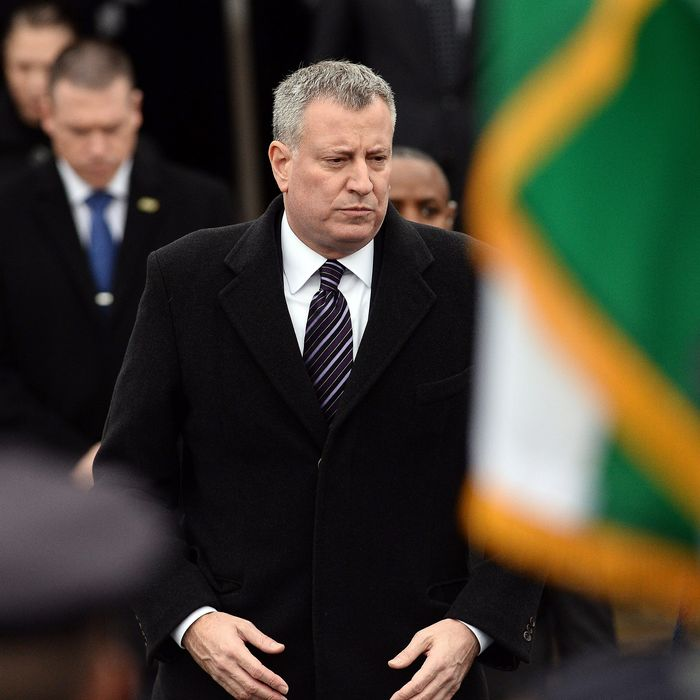 New York City Mayor Bill de Blasio attends the funeral of New York Police Department (NYPD) officer Wenjian Liu in New York's borough of Brooklyn on January 4, 2015.
