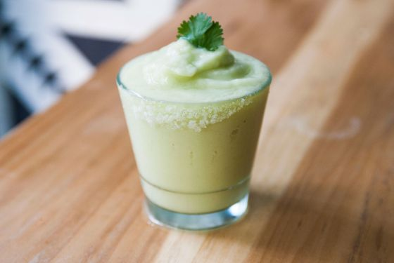 Javelina's Frozen Avocado and Cilantro Margarita, garnished with a cilantro leaf.