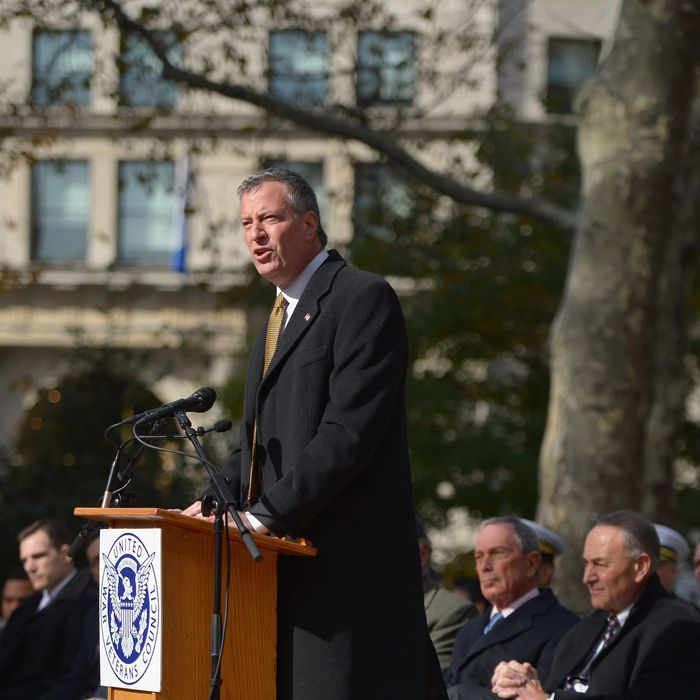 NYC Public Advocate/Mayor-elect Bill de Blasio addresses the audience during the 94th annual New York City Veterans Day Parade on 5th Avenue on November 11, 2013 in New York City. The parade is the largest of its kind in the country and this year is especially dedicated to women serving in the armed forces.