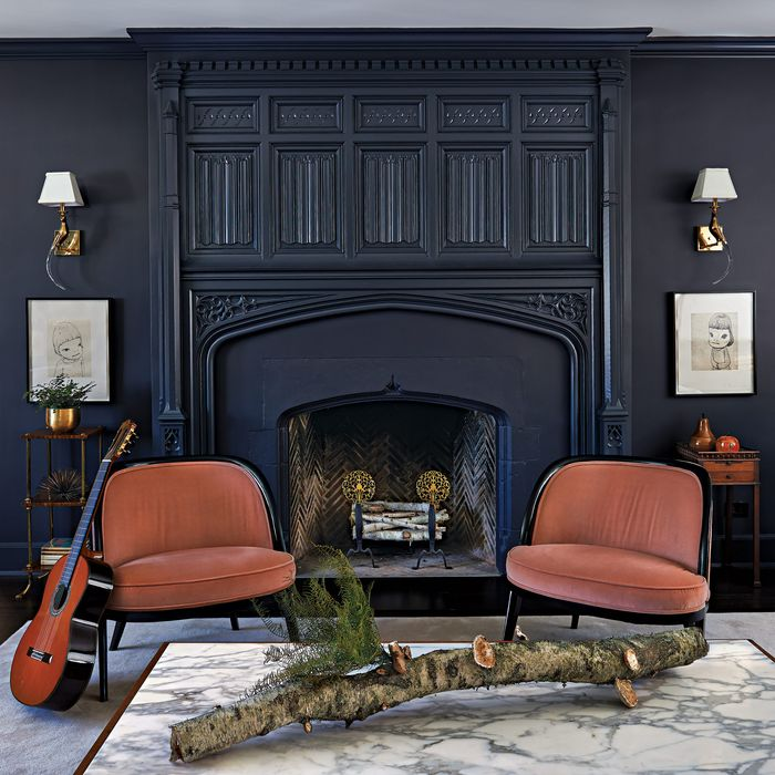 The living room's moody palette helped make the couple's art collection pop.
