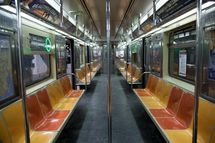 A Number 7 subway train waits for passengers at the Times Square, 42nd Street station, Manhattan, New York City, USA
