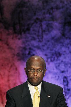 HANOVER, NH - OCTOBER 11:  Former CEO of Godfather's Pizza Herman Cain looks on during the Republican Presidential debate hosted by Bloomberg and the Washington Post on October 11, 2011 at Dartmouth College in Hanover, New Hampshire. Eight GOP candidates met for the first debate of the 2012 campaign focusing solely on the economy.  (Photo by Justin Sullivan/Getty Images)