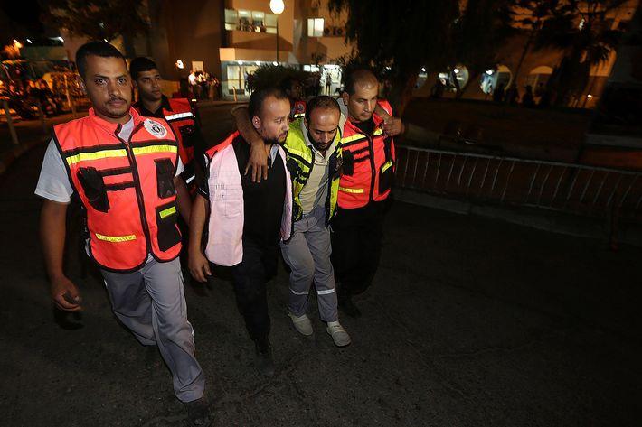GAZA CITY, GAZA - JULY 18:  A Palestinian, injured in Israeli airstrikes within 'Operation Protective Edge', is taken to the Al Shifa Hospital in Gaza City, Gaza on 18 July, 2014. (Photo by Mustafa Hassona/Anadolu Agency/Getty Images)