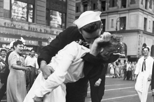 14 Aug 1945, Manhattan, New York City, New York State, USA --- A sailor kisses a nurse passionately in Manhattan's Times Square as New York City celebrates the surrender of Japan on August 14, 1945. Kissing strangers was a common elated reaction to the news in Times Square. --- Image by ? CORBIS