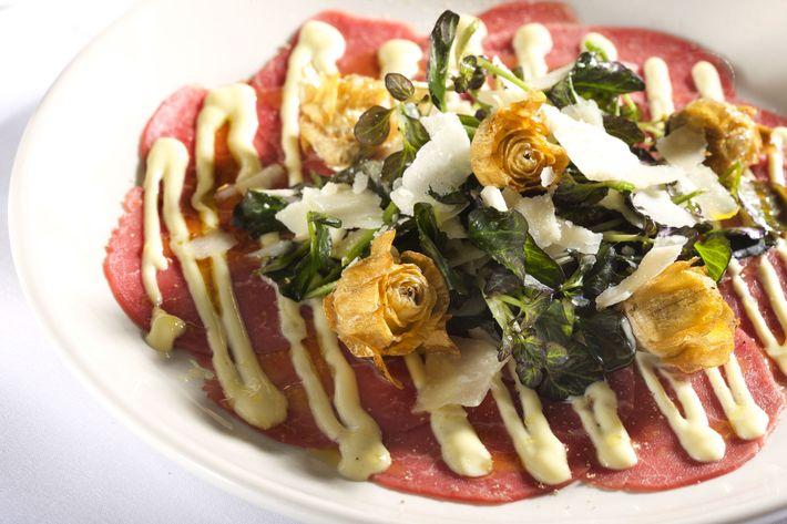 Beef carpaccio with crisp artichokes, red watercress, Meyer lemon.