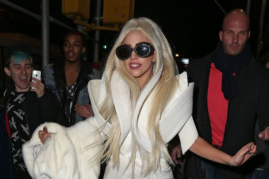 Lady Gaga runs down the street for three blocks in an outrageous white outfit with heels in NYC and almost trips at one point.