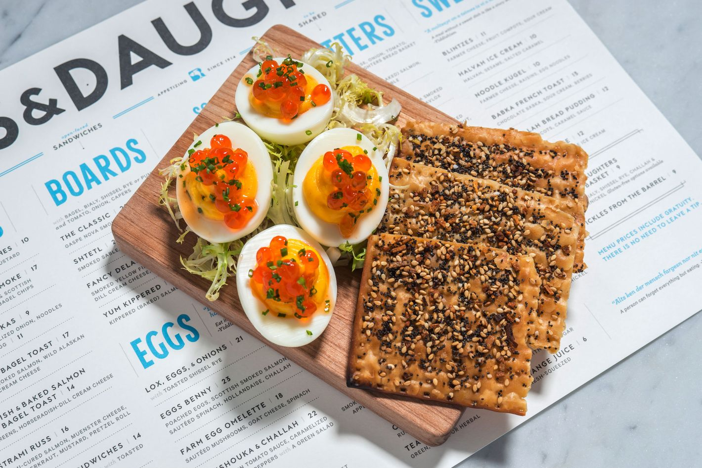 Deviled eggs with wild Alaskan salmon roe — served with everything matzo.