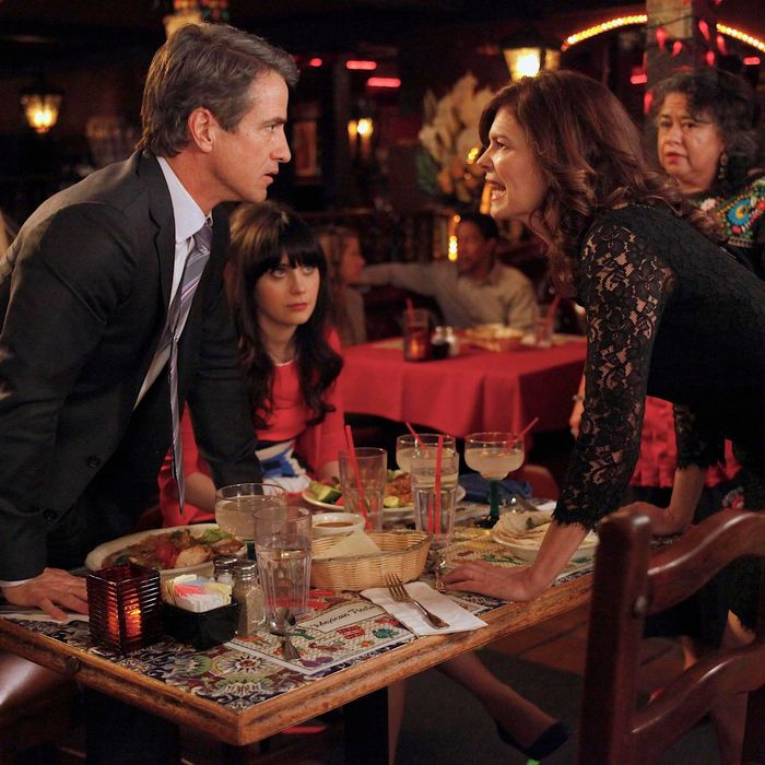 NEW GIRL: Jess (Zooey Deschanel, C) watches as Russell (guest star Dermot Mulroney, L) and his ex-wife Ouli (guest star Jeanne Tripplehorn, R) have a heated argument in the