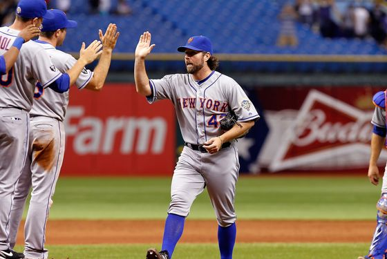 ST PETERSBURG, FL - JUNE 13:  Pitcher R.A. Dickey #43 of the New York Mets is congratulated after his one hit complete game against the Tampa Bay Rays at Tropicana Field on June 13, 2012 in St. Petersburg, Florida.  (Photo by J. Meric/Getty Images)